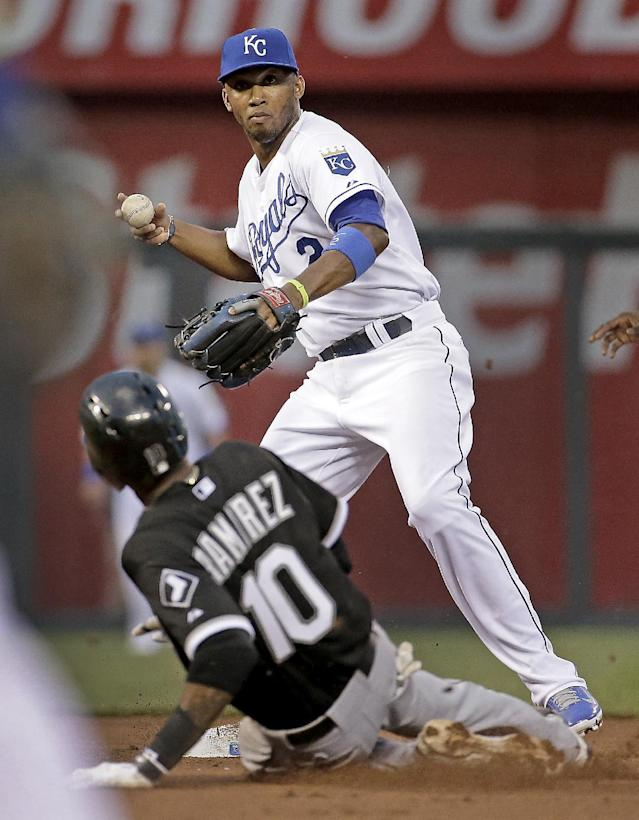 Kansas City Royals shortstop Alcides Escobar throws to first for the double play hit into by Chicago White Sox's Paul Konerko after forcing Alexei Ramirez out at second during the fourth inning of a baseball game Wednesday, May 21, 2014, in Kansas City, Mo. (AP Photo/Charlie Riedel)