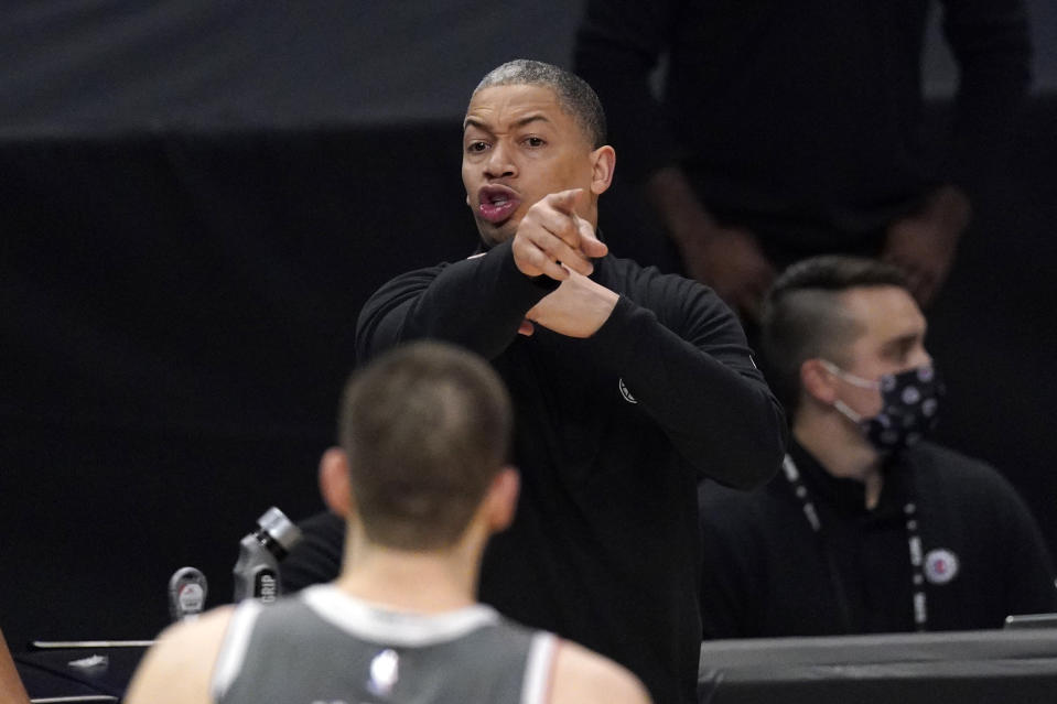 Los Angeles Clippers head coach Tyronn Lue gestures during the second half in Game 4 of the NBA basketball Western Conference Finals against the Phoenix Suns Saturday, June 26, 2021, in Los Angeles. (AP Photo/Mark J. Terrill)