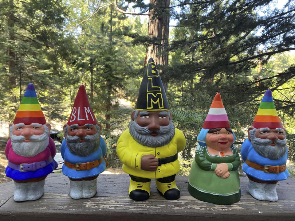 This Sept. 21, 2020, photo provided by Ashleigh Boutelle in Twin Peaks, Calif., shows Black Lives Matter gnomes and gay pride gnomes he painted and is selling online. Amid all the Black Lives Matter themed T-shirts, face masks and signs appearing in recent months, some unconventional merchandise has been popping up on online crafts marketplace Etsy. (Ashleigh Boutelle via AP)