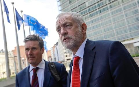 Jeremy Corbyn, leader of the U.K.'s opposition Labour Party, right, speaks to journalists as he stands beside Keir Starmer - Credit:  Dario Pignatelli