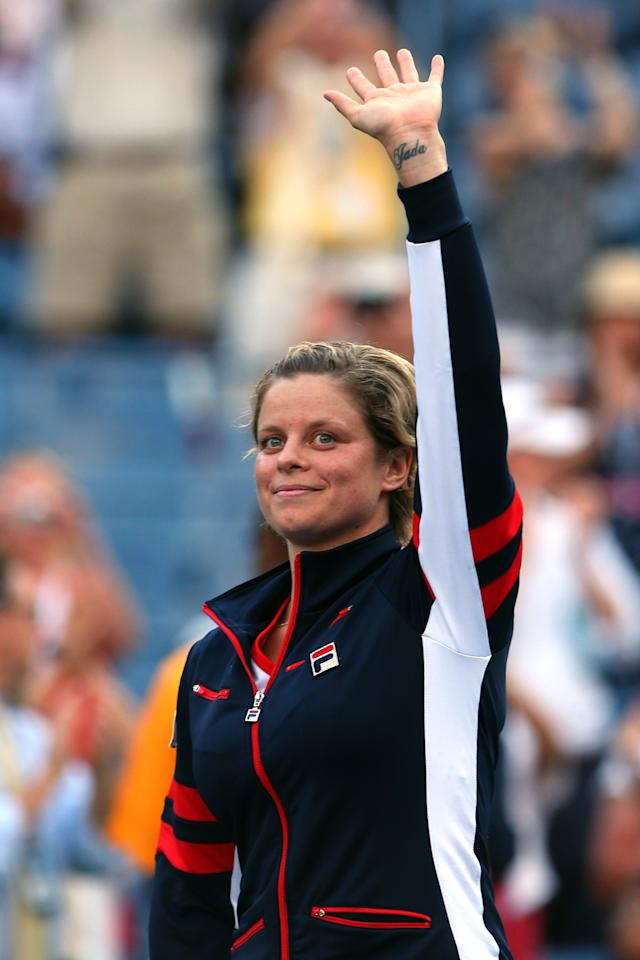 NEW YORK, NY - AUGUST 29:  Kim Clijsters of Belgium waves to the crowd before walking off court following her defeat to Laura Robson of Great Britain after their women's singles second round match on Day Three of the 2012 US Open at USTA Billie Jean King National Tennis Center on August 29, 2012 in the Flushing neigborhood of the Queens borough of New York City.  (Photo by Cameron Spencer/Getty Images)
