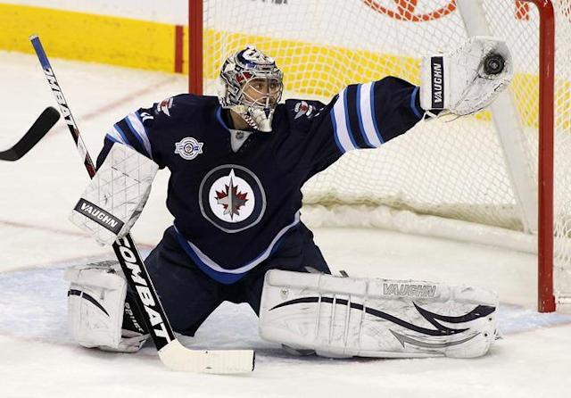 WINNIPEG, CANADA - FEBRUARY 27: Ondrej Pavelec #31 of the Winnipeg Jets makes a save in a game against the Edmonton Oilers in NHL action at the MTS Centre on February 27, 2012 in Winnipeg, Manitoba, Canada. (Photo by Marianne Helm/Getty Images) *** BESTPIX ***