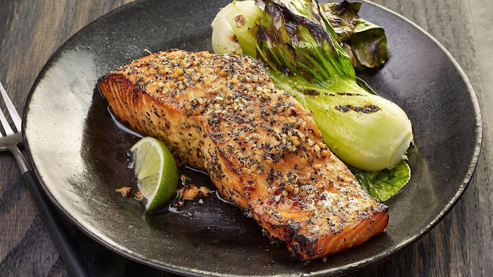 """<p><a href=""""https://www.thedailymeal.com/cook/how-grill-salmon-perfectly-every-time?referrer=yahoo&category=beauty_food&include_utm=1&utm_medium=referral&utm_source=yahoo&utm_campaign=feed"""" rel=""""nofollow noopener"""" target=""""_blank"""" data-ylk=""""slk:You need to grill salmon this summer"""" class=""""link rapid-noclick-resp"""">You need to grill salmon this summer</a>. This easy-to-follow recipe uses a bold marinade with soy sauce, lime juice, pepper, ginger, garlic, sesame seeds and red pepper.</p> <p><a href=""""https://www.thedailymeal.com/best-recipe/grilled-salmon-easy-soy-sauce-pepper-marinade?referrer=yahoo&category=beauty_food&include_utm=1&utm_medium=referral&utm_source=yahoo&utm_campaign=feed"""" rel=""""nofollow noopener"""" target=""""_blank"""" data-ylk=""""slk:For the Grilled Salmon With Peppered Soy Glaze recipe, click here."""" class=""""link rapid-noclick-resp"""">For the Grilled Salmon With Peppered Soy Glaze recipe, click here.</a></p>"""