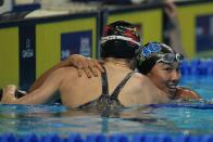 Torri Huske hugs Kelsi Dahlia after winning the Women's 100 Butterfly during wave 2 of the U.S. Olympic Swim Trials on Monday, June 14, 2021, in Omaha, Neb. (AP Photo/Jeff Roberson)