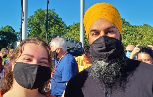 Meghan Piironen, 19, with NDP Leader Jagmeet Singh, is one of several student candidates running in the federal election. The second-year political science student at the University of Ottawa is running for the party in Ontario's Haldimand-Norfolk riding, balancing studying with campaigning. (Submitted by Meghan Piironen - image credit)