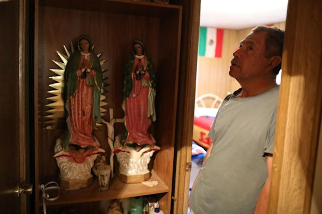 <p>Roberto Obispo, 65, stepfather of immigrant Rosa Sabido, stands next to a shrine in his home, which is next door to the home Rosa left to live in sanctuary in the United Methodist Church while facing deportation, in Cortez, Colo., July 19, 2017. (Photo: Lucy Nicholson/Reuters) </p>