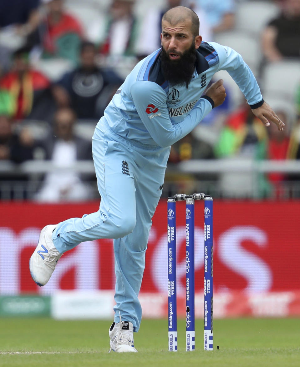 FILE - In this file photo dated Tuesday, June 18, 2019, England's Moeen Ali bowls during the Cricket World Cup match between England and Afghanistan at Old Trafford in Manchester, England. A four-match test series between England and India begins Friday Feb. 5, 2021, with England's spin bowlers including Leach facing off against an intimidating Indian batting lineup featuring Virat Kohli, who is available again. (AP Photo/Rui Vieira, FILE)