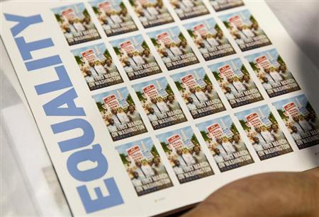 """A page of U.S. Postal Service limited-edition stamps commemorating the 1963 'March on Washington for Jobs and Freedom"""" is displayed in Washington"""