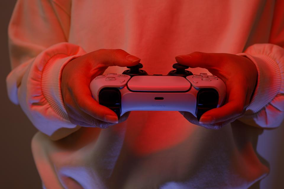Riga, Latvia - November 23 2020: Sony PlayStation 5 game console on red background.