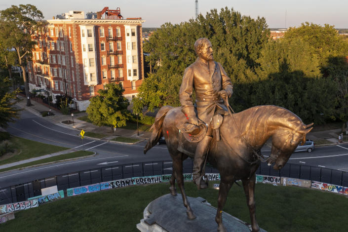The statue of Confederate Gen. Robert E. Lee is bathed in the late sun on Monument Avenue in Richmond, Va., Monday, Sept. 6, 2021. The statue is scheduled to be removed by the state Wednesday, Sept. 8 after a ruling by the Virginia Supreme Court. (AP Photo/Steve Helber)