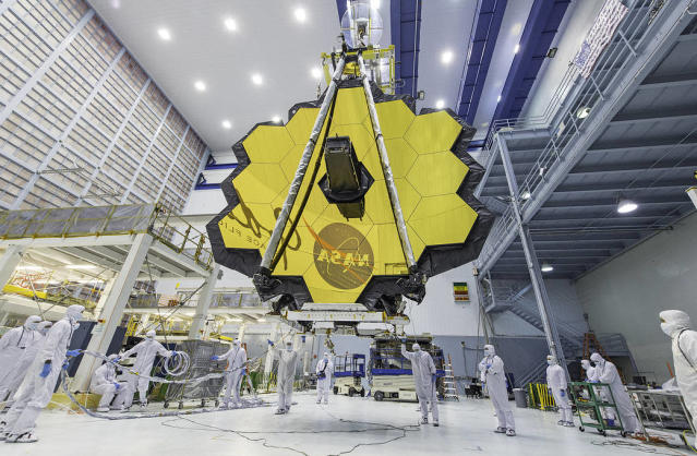 <p>NASA technicians lift the James Webb Space Telescope, successor to Hubble Space Telescope, using a crane to move it inside a clean room at NASA's Goddard Space Flight Center in Greenbelt, Md in this photo released April 25, 2017. The most powerful space telescope ever built, once launched into space, the Webb telescope'€™s 18-segmented gold mirror is specially designed to capture infrared light from the first galaxies that formed in the early universe, and will help the telescope peer inside dust clouds where stars and planetary systems are forming today. (Photo: NASA/Desiree Stover) </p>
