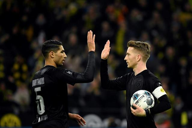 Marco Reus (R) celebrates with Achraf Hakimi during a 5-0 rout of Fortuna Duesseldorf (AFP Photo/INA FASSBENDER)