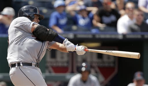 Detroit Tigers' Brayan Pena hits an RBI-sacrifice fly during the seventh inning of a baseball game against the Kansas City Royals, Sunday, July 21, 2013, in Kansas City, Mo. (AP Photo/Charlie Riedel)