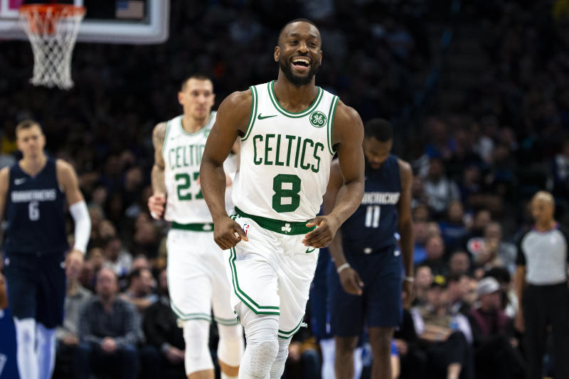 Boston Celtics guard Kemba Walker (8) smiles as he runs down the court after making a 3-pointer during the second half of the team's NBA basketball game against the Dallas Mavericks on Wednesday, Dec. 18, 2019, in Dallas. (AP Photo/Sam Hodde)