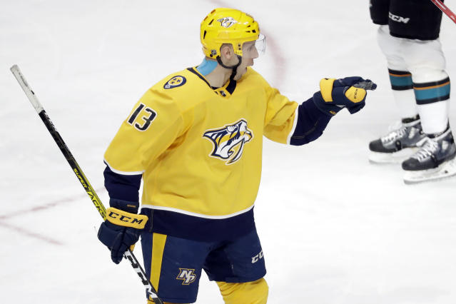 Nashville Predators center Nick Bonino celebrates after scoring a goal against the San Jose Sharks in the third period of an NHL hockey game Tuesday, Dec. 10, 2019, in Nashville, Tenn. (AP Photo/Mark Humphrey)