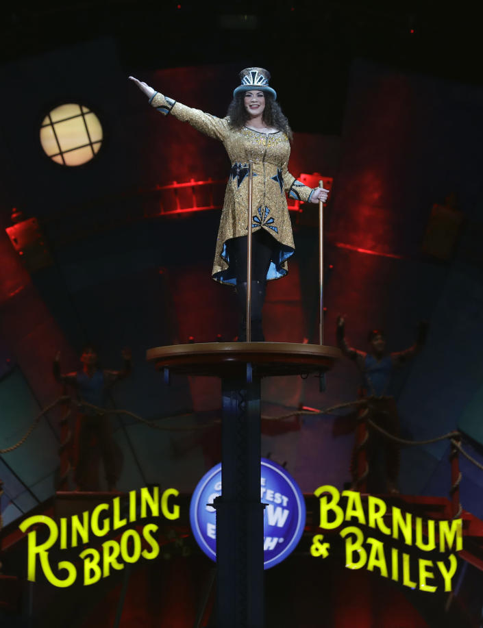 """Ringling Bros. and Barnum & Bailey Ringmaster Kristen Michelle Wilson appears during a performance Saturday, Jan. 14, 2017, in Orlando, Fla. The Ringling Bros. and Barnum & Bailey Circus will end the """"The Greatest Show on Earth"""" in May, following a 146-year run of performances. Kenneth Feld, the chairman and CEO of Feld Entertainment, which owns the circus, told The Associated Press, declining attendance combined with high operating costs are among the reasons for closing. (AP Photo/Chris O'Meara)"""