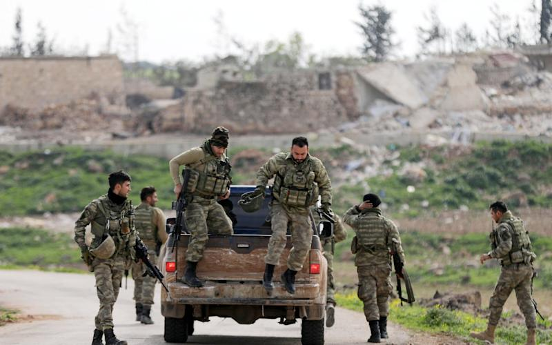 Turkish-backed Free Syrian Army fighters are seen in Maryamayn in eastern Afrin - REUTERS