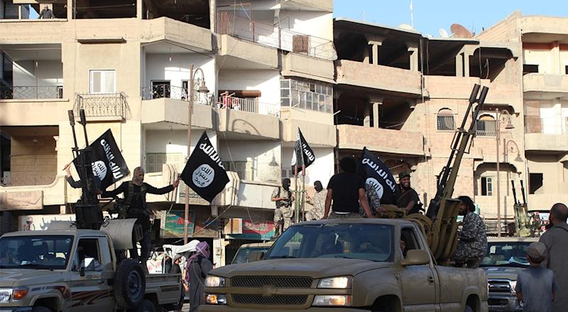 Members of the Islamic state militant group parade through in the northern rebel-held Syrian city of Raqa in this jihadist media photo