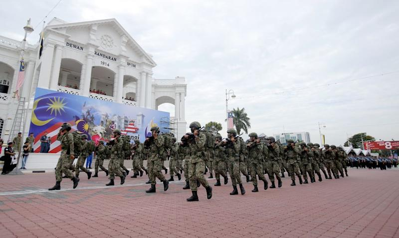 Military personnel rehearse for the state-level National Day celebration in front of the Ipoh Town Hall, August 29, 2018.