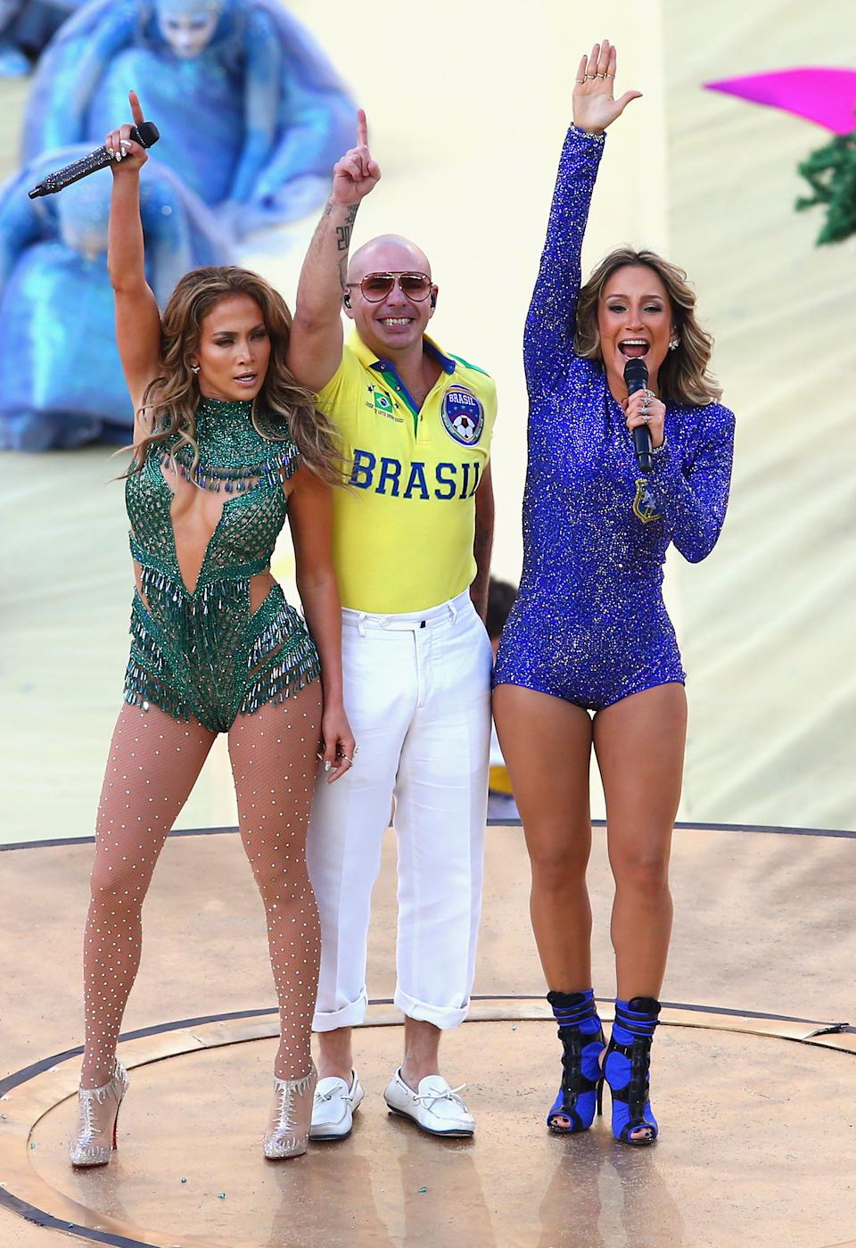 SAO PAULO, BRAZIL - JUNE 12:  (L-R) Singers Jennifer Lopez, Pitbull and Claudia Leitte perform during the Opening Ceremony of the 2014 FIFA World Cup Brazil prior to the Group A match between Brazil and Croatia at Arena de Sao Paulo on June 12, 2014 in Sao Paulo, Brazil.  (Photo by Elsa/Getty Images)