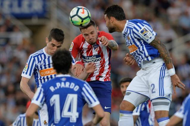 Atletico Madrid slumped to a 3-0 defeat at resurgent Real Sociedad on Thursday which means Barcelona need one more victory to wrap up a 25th Spanish La Liga title while Malaga were relegated after losing 1-0 at Levante