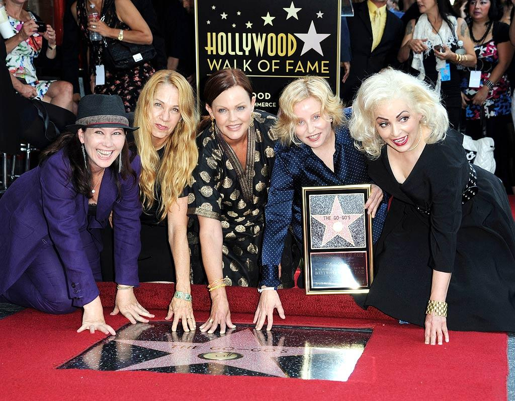 """You haven't been forgotten, Go-Go's! The all-girl band from the '80s received a star on the Hollywood Walk of Fame on Thursday. All of the members -- including (L-R) Kathy Valentine, Charlotte Caffey, Belinda Carlisle, Gina Schock and Jane Wiedlin -- showed up to accept the honor. Valerie Macon/<a href=""""http://www.gettyimages.com/"""" target=""""new"""">GettyImages.com</a> - August 11, 2011"""