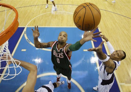 Milwaukee Bucks forward Drew Gooden (0) goes up for an offensive rebound against Dallas Mavericks forward Shawn Marion, right, in the first half of an NBA basketball game Friday, Jan. 13, 2012, in Dallas. (AP Photo/Tony Gutierrez)