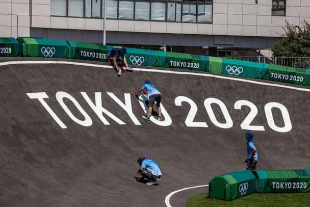 PHOTO: Staff work on the Olympic BMX racing track at Ariake Urban Sports Park in Tokyo, Japan, on July 22, 2021. (Carl Court/Getty Images)