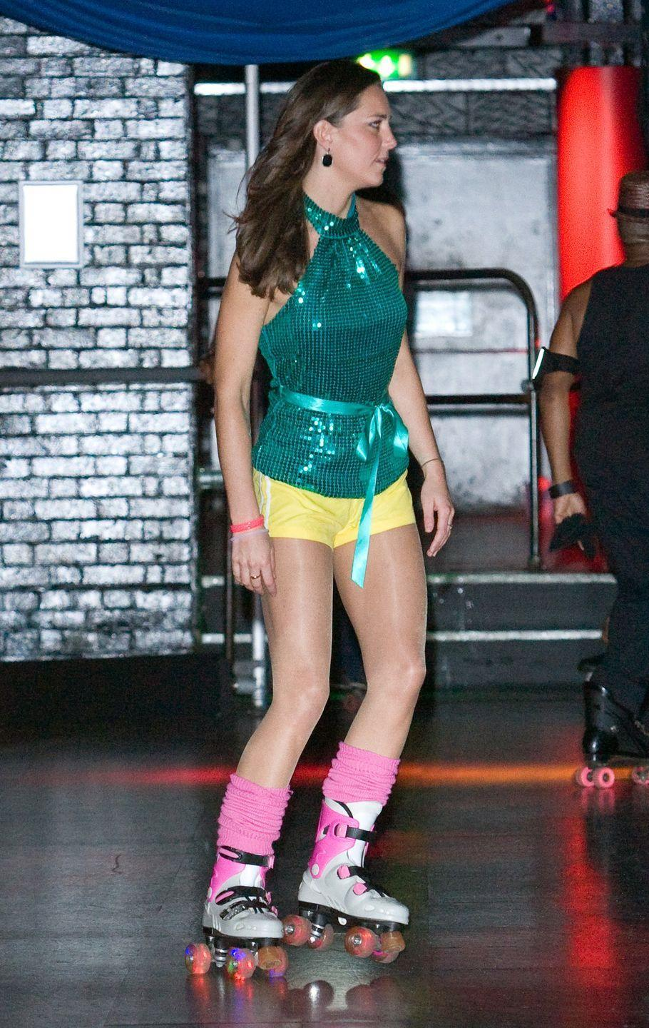 <p>Skating in a sequined halter top and yellow athletic shorts at the Day-Glo Midnight Roller Disco in South London.</p>