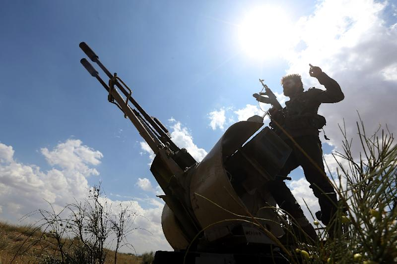Fighters loyal to Libya's Government of National Accord (GNA) hold a position west of the city of Aziziah, some 60 kilometres southwest of the capital Tripoli (AFP Photo/Mahmud TURKIA)