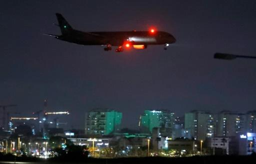 A cargo plane operated by Etihad Airways carrying medical aid to help Palestinians cope with the coronavirus pandemic  prepares to land at Israel's Ben Gurion Airport near Tel Aviv on June 9, 2020