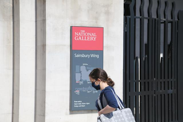 A woman wears a mask outside The National Gallery in London. (Getty Images)
