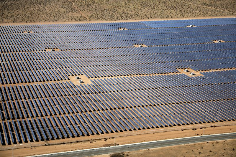 FILE PHOTO: An array of solar panels is seen in the desert near Victorville