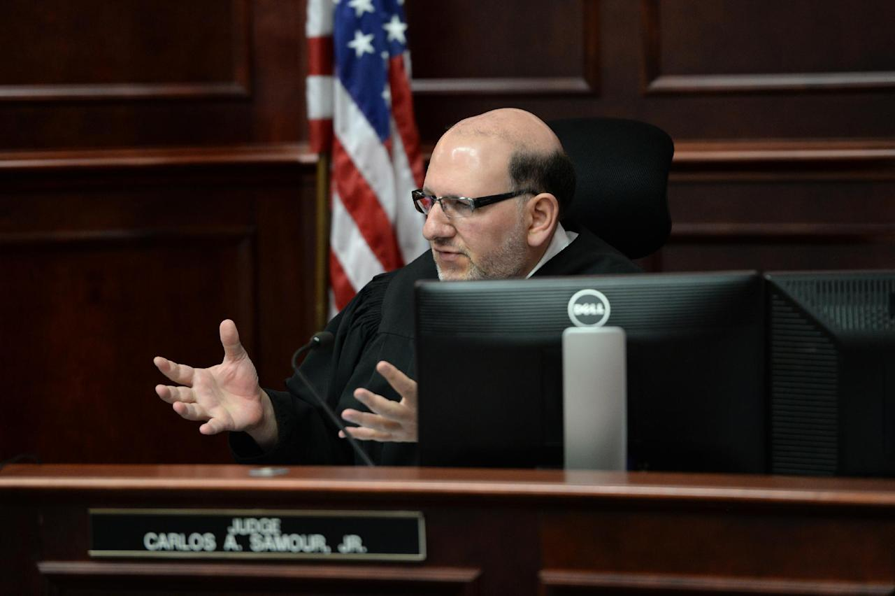 Judge Carlos Samour, Jr. speaks as he sentences Colorado theatre shooter James Holmes on Wednesday, Aug. 26, 2015 in Centennial, Colo. Holmes was formally sentenced to life in prison without parole. Holmes killed 12 people and injured 70 others in the July 20, 2012 ambush. (RJ Sangosti/The Denver Post via AP, Pool)