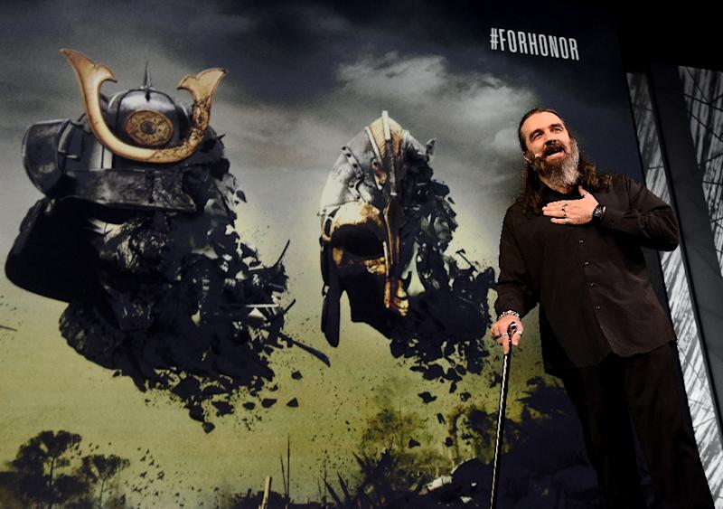 """Jason VandenBerghe, creative director of Ubisoft, announces the """"For Honor"""" game during the Ubisoft E3 press conference before the opening day of the Electronic Entertainment Expo, known as E3 in Los Angeles, California on June 15, 2015 (AFP Photo/Mark Ralston)"""