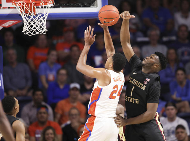Florida State forward Raiquan Gray (1) blocks the shot of Florida forward Kerry Blackshear Jr. (24) during the first half of an NCAA college basketball game Sunday, Nov. 10, 2019, in Gainesville, Fla. (AP Photo/Matt Stamey)