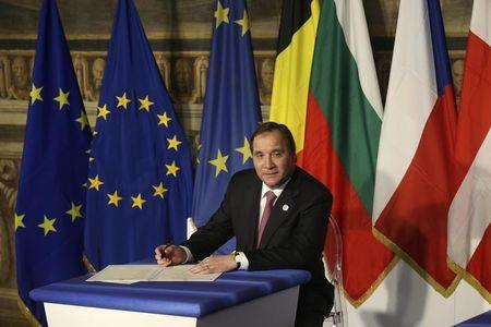 Sweden's PM Lofven prepares to sign a document during the EU leaders meeting on the 60th anniversary of the Treaty of Rome, in Rome