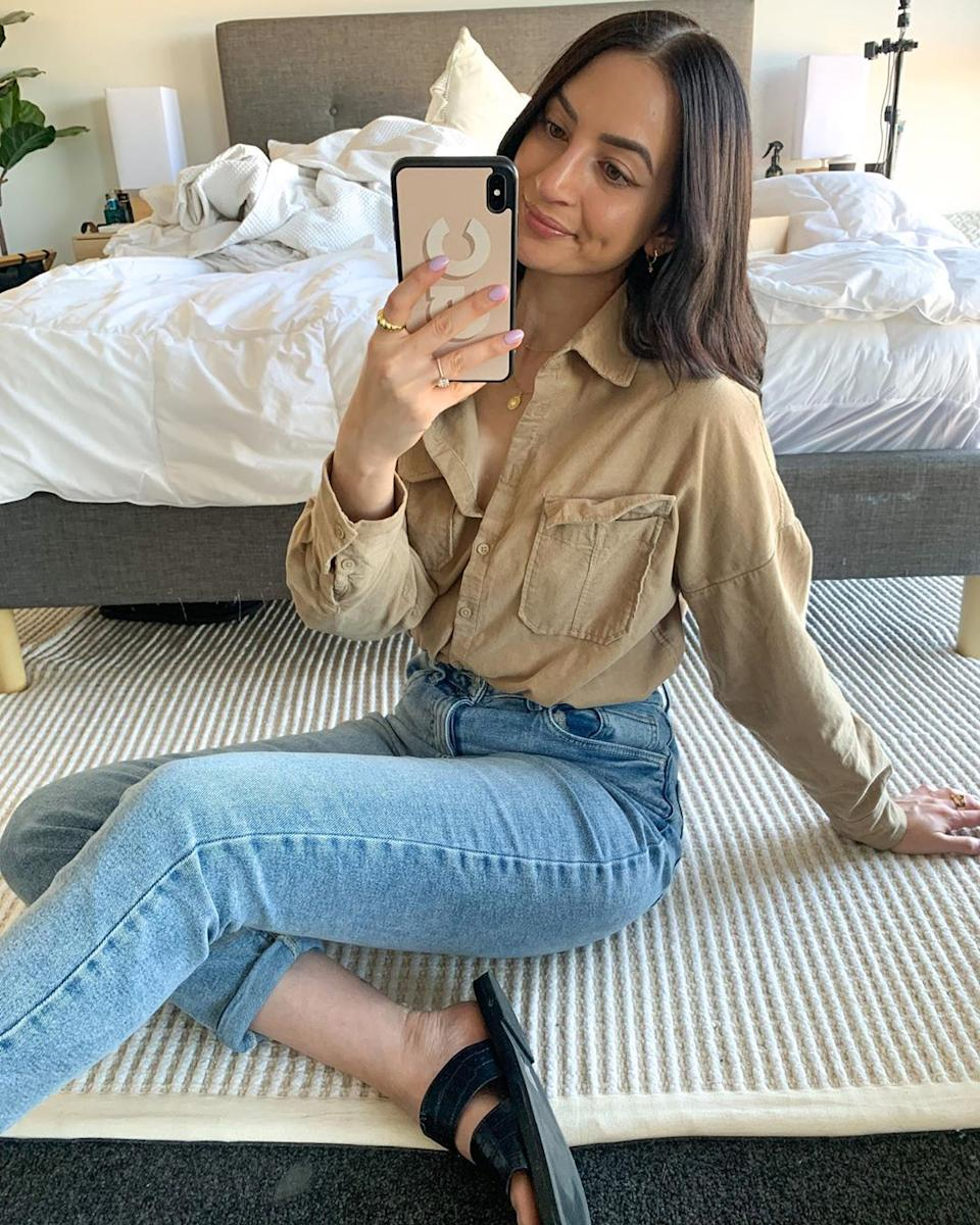 The shirt also looks great tucked into light-wash denim. Photo: Instagram/thisisgenevieve_.