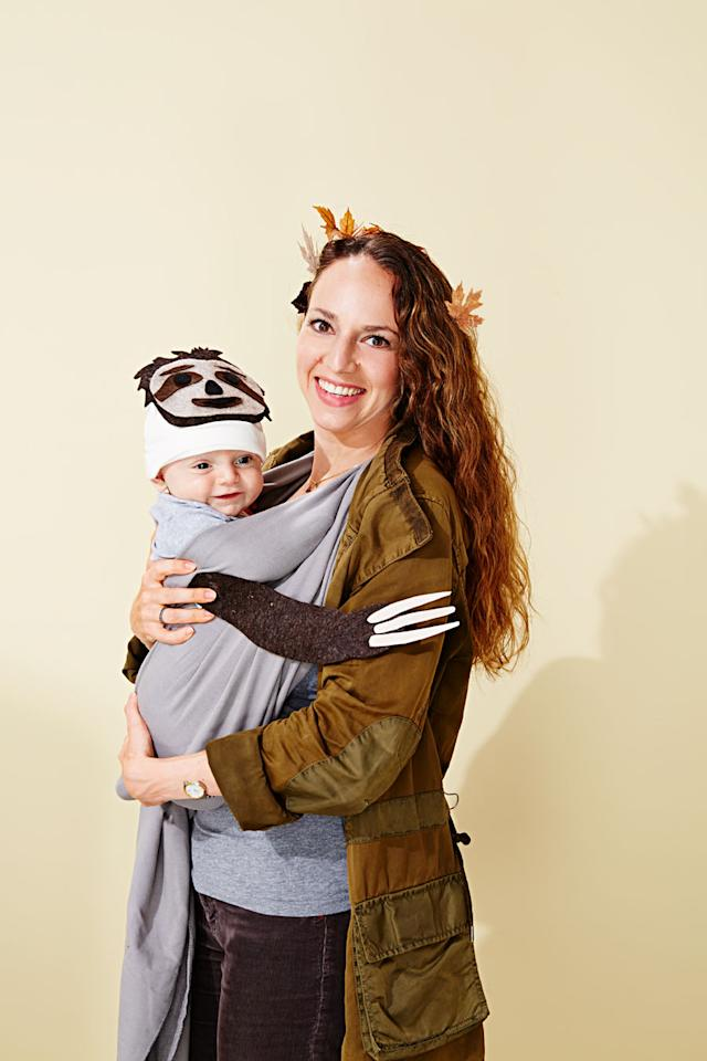 """<p>There's no trick-or-treater too small for Halloween. The trick to this duo? We used a baby wrap carrier to disguise a smiling little one as a sloth slinging from a tree branch. To create this costume, print the <a href=""""http://assets.marthastewart.com/d8/SlothWeb/SlothWeb_L1016.pdf"""">template</a> onto 8 1/2-by-11-inch paper and cut out. Use the template to cut out felt shapes, then glue the pieces together, and pin them to Baby's wrap and hat. Mom can wear brown and tuck leaves in her hair.</p>"""