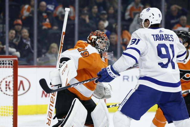 Philadelphia Flyers' Carter Hart, left, cannot stop a goal by Toronto Maple Leafs' Travis Dermott as John Tavares, right, looks on during the third period of an NHL hockey game, Tuesday, Dec. 3, 2019, in Philadelphia. (AP Photo/Matt Slocum)