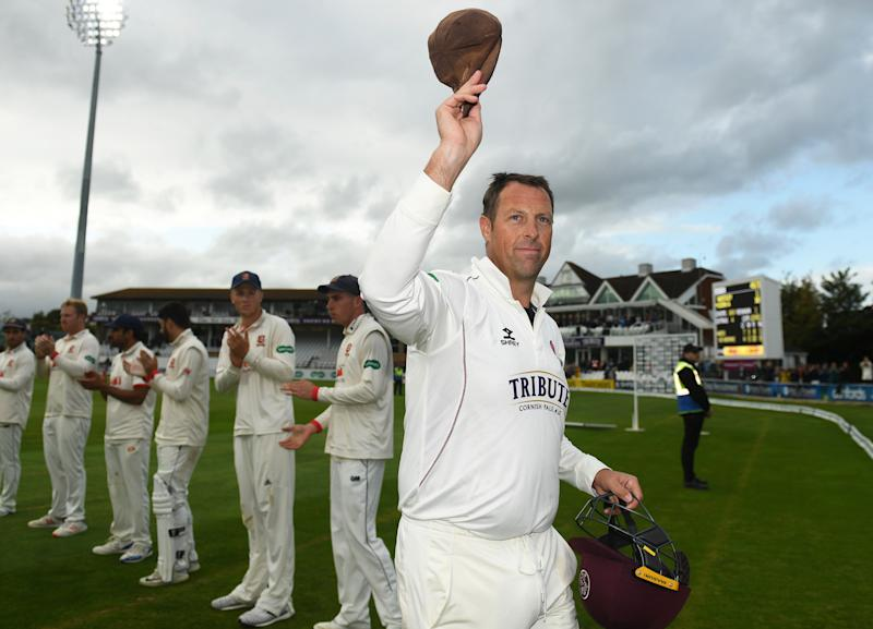 TAUNTON, ENGLAND - SEPTEMBER 26: Marcus Trescothick of Somerset raises his cap to the crowd as he is given a guard of honour on his final match before retiring during Day Four of the Specsavers County Championship Division One match between Somerset and Essex at The Cooper Associates County Ground on September 26, 2019 in Taunton, England. (Photo by Harry Trump/Getty Images)