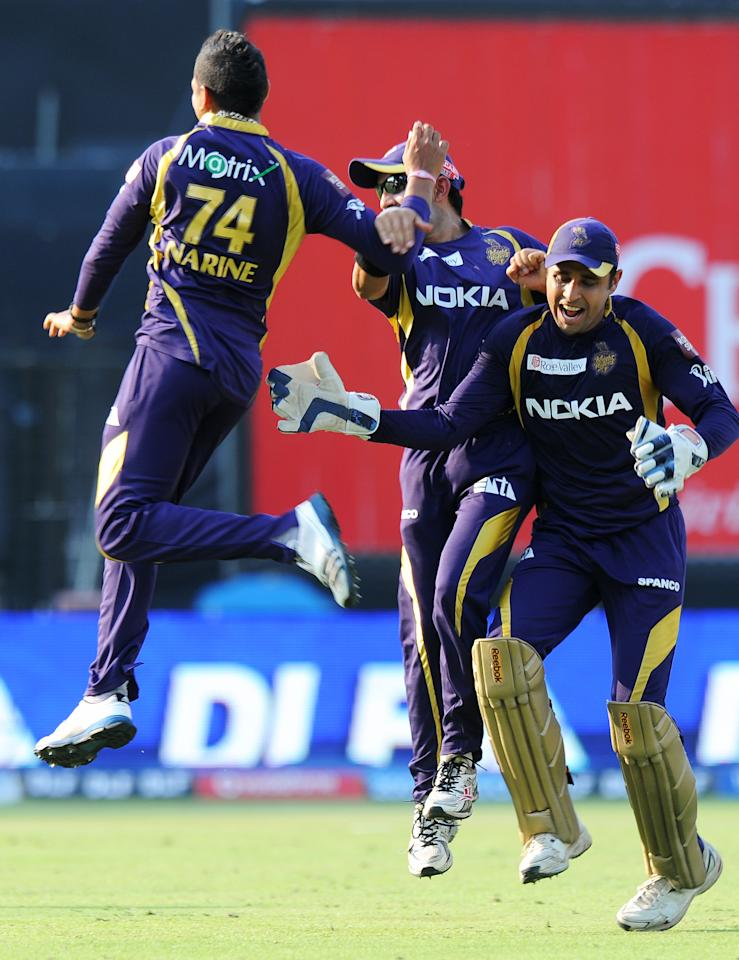 Kolkata Knight Riders bowler Sunil Narine (L) celebrates with teammates Gautam Gambhir (C) and Manvinder Bisla (R) after taking the wicket of Kings XI Punjab batsman Shaun Marsh (unseen) during the IPL Twenty20 cricket match between Kolkata Knight Riders and Kings XI Punjab at The Eden Gardens in Kolkata on April 15, 2012. RESTRICTED TO EDITORIAL USE. MOBILE USE WITHIN NEWS PACKAGE. AFP PHOTO/Dibyangshu SARKAR (Photo credit should read DIBYANGSHU SARKAR/AFP/Getty Images)