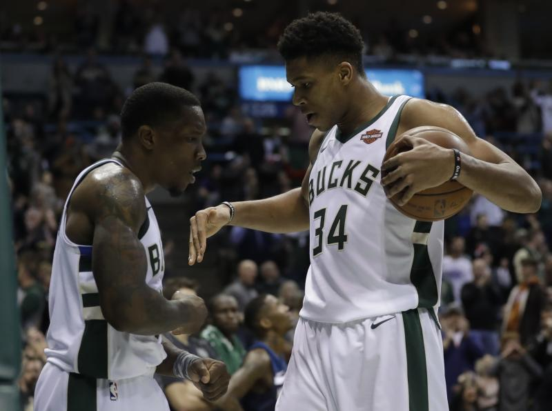 Milwaukee Bucks' Eric Bledsoe and Giannis Antetokounmpo celebrate during the second half of an NBA basketball game against the Minnesota Timberwolves Thursday, Dec. 28, 2017, in Milwaukee. The Bucks won 102-96. (AP Photo/Morry Gash)