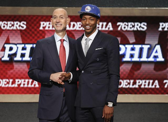 Elfrid Payton, right, poses for a photo with NBA commissioner Adam Silver after being selected as the 10th overall pick by the Philadelphia 76ers during the 2014 NBA draft, Thursday, June 26, 2014, in New York. (AP Photo/Jason DeCrow)