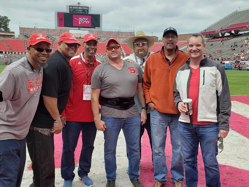 "Erik Kramer (R), pictured at a game involving his alma mater, N.C. State, says, ""I am walking through the wreckage and rubble of my life. But at least I feel normal walking through it."" (Special to Yahoo Sports)"