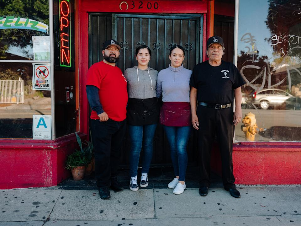 From left to right, Javier, Rosio, Violeta and Silverio Moreno outside their East Los Angeles restaurant, Birrieria Nochistlán, which specializes in Zacatecan-style birria on Jan. 30, 2021. With infinite variations, birria, the regional Mexican stew is now a social-media star in Los Angeles and beyond. (Rozette Rago/The New York Times)
