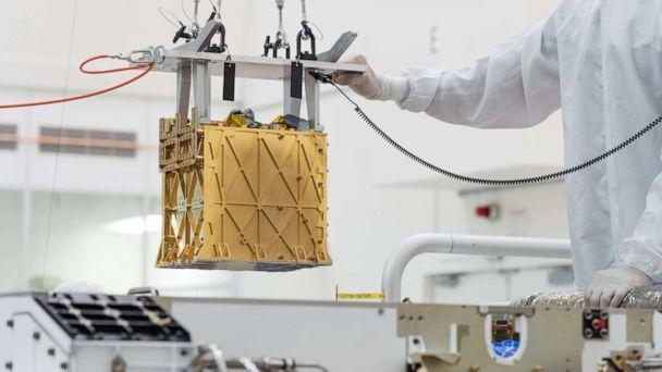 PHOTO: The Mars Oxygen In-Situ Resource Utilization Experiment (MOXIE) instrument is lowered into the Perseverance rover, March 21, 2019 at NASA's Jet Propulsion Laboratory, in Pasadena, Calif. (NASA/JPL-Caltech)