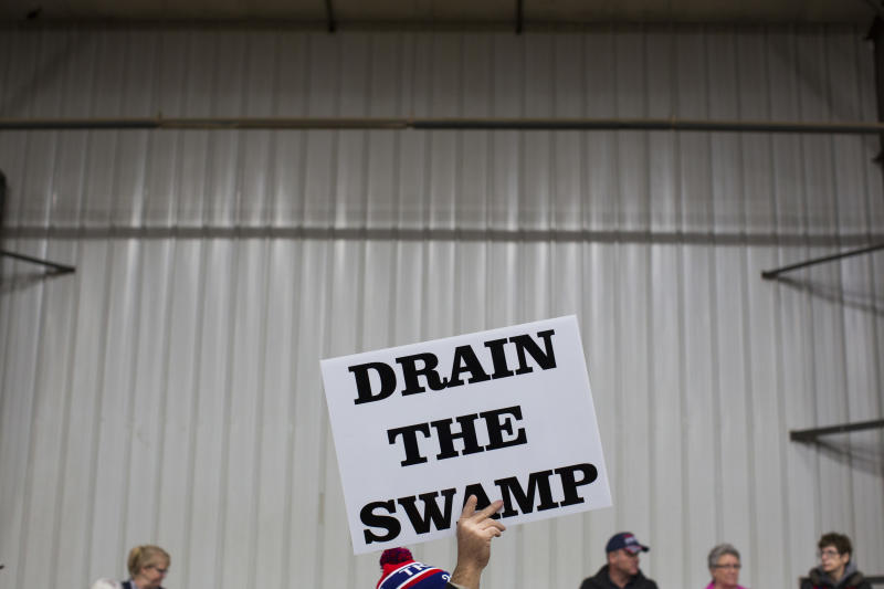 """FILE - In this Oct. 27, 2016, file photo, supporters of then-Republican presidential candidate Donald Trump hold signs during a campaign rally in Springfield, Ohio. Despite President Donald Trump's campaign to """"drain the swamp"""" of lobbyists and special interests, Washington's influence industry is alive and well _ and growing. Former members of the Trump transition team, presidential campaign, administration and friends have set up shop as lobbyists and cashed in on connections, according to a new analysis by Public Citizen, a public interest group, and reviewed by The Associated Press. (AP Photo/ Evan Vucci, file)"""