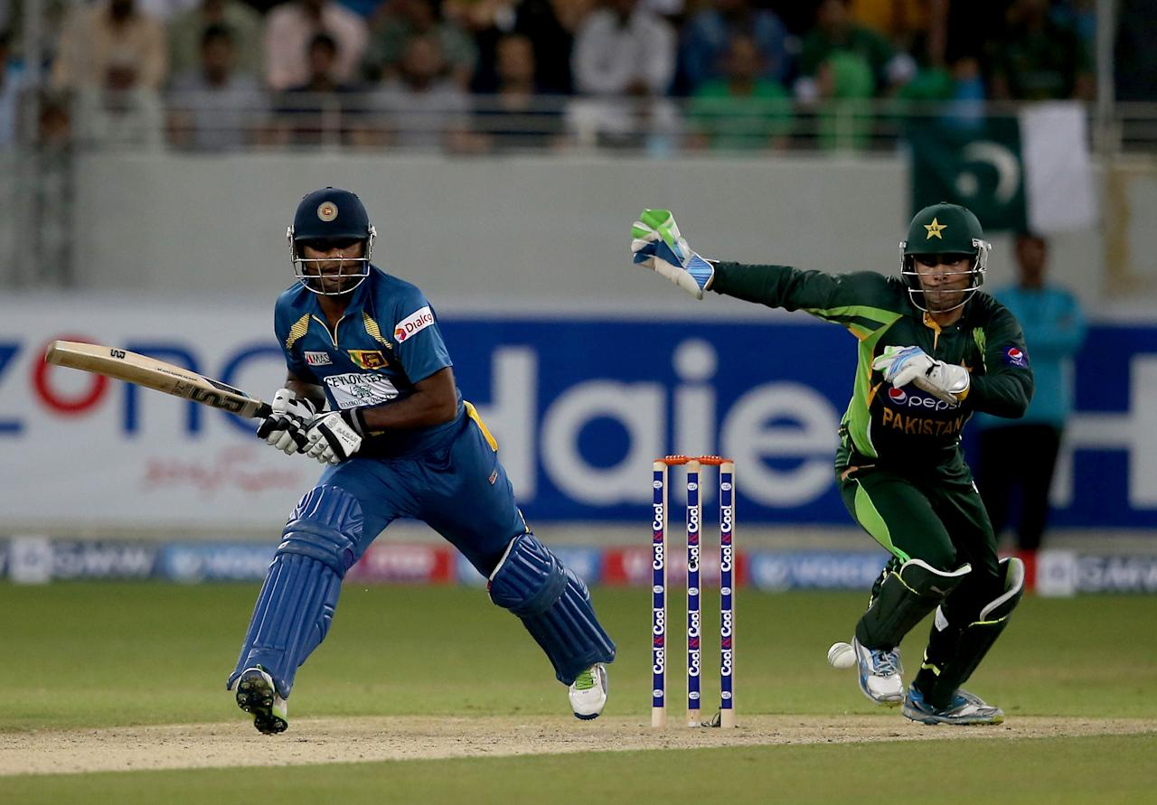 DUBAI, UNITED ARAB EMIRATES - DECEMBER 13:  Seekugu Prasanna of Sri Lanka bats during the second Twenty20 International match between Pakistan and Sri Lanka at Dubai Sports City Cricket Stadium on December 13, 2013 in Dubai, United Arab Emirates.  (Photo by Francois Nel/Getty Images)