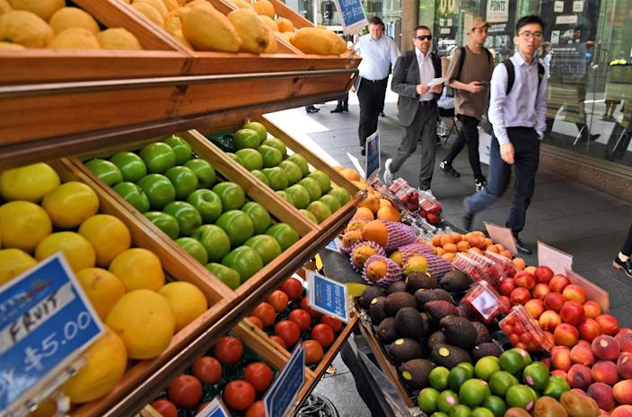 A fruit vendor tends to his stall in Sydney's central business district on November 29, 2016 (AFP Photo/William West)